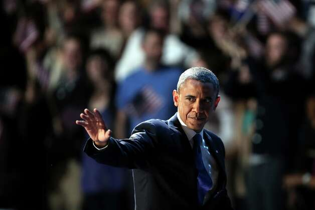 CHICAGO, IL - NOVEMBER 06:  U.S. President Barack Obama waves to supporters after his victory speech at McCormick Place November 6, 2012 in Chicago, Illinois. Obama won reelection against Republican candidate, former Massachusetts Governor Mitt Romney.  (Photo by Spencer Platt/Getty Images) Photo: Spencer Platt, Getty Images / 2012 Getty Images