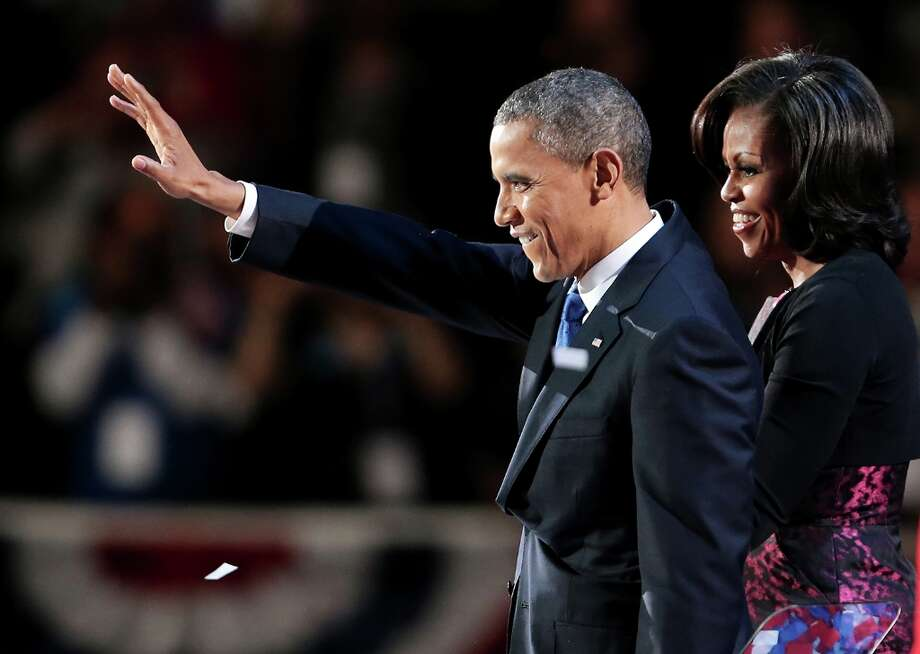 CHICAGO, IL - NOVEMBER 06:  U.S. President Barack Obama stands on stage with first lady Michelle Obama after his victory speech on election night at McCormick Place November 6, 2012 in Chicago, Illinois. Obama won reelection against Republican candidate, former Massachusetts Governor Mitt Romney.  (Photo by Spencer Platt/Getty Images) Photo: Spencer Platt, Getty Images / 2012 Getty Images