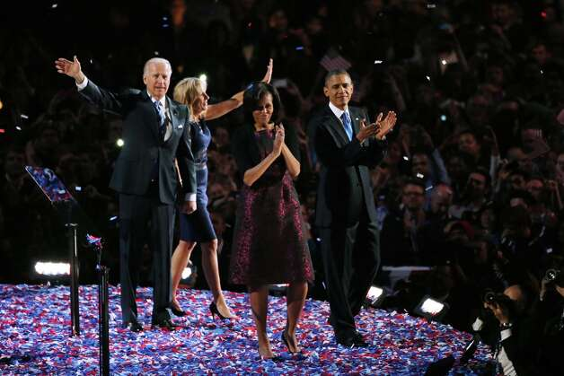 CHICAGO, IL - NOVEMBER 06:  U.S. President Barack Obama stands on stage with first lady Michelle Obama, U.S. Vice President Joe Biden and Dr. Jill Biden after his victory speech on election night at McCormick Place November 6, 2012 in Chicago, Illinois. Obama won reelection against Republican candidate, former Massachusetts Governor Mitt Romney.  (Photo by Jonathan Daniel/Getty Images) Photo: Jonathan Daniel, Getty Images / 2012 Getty Images
