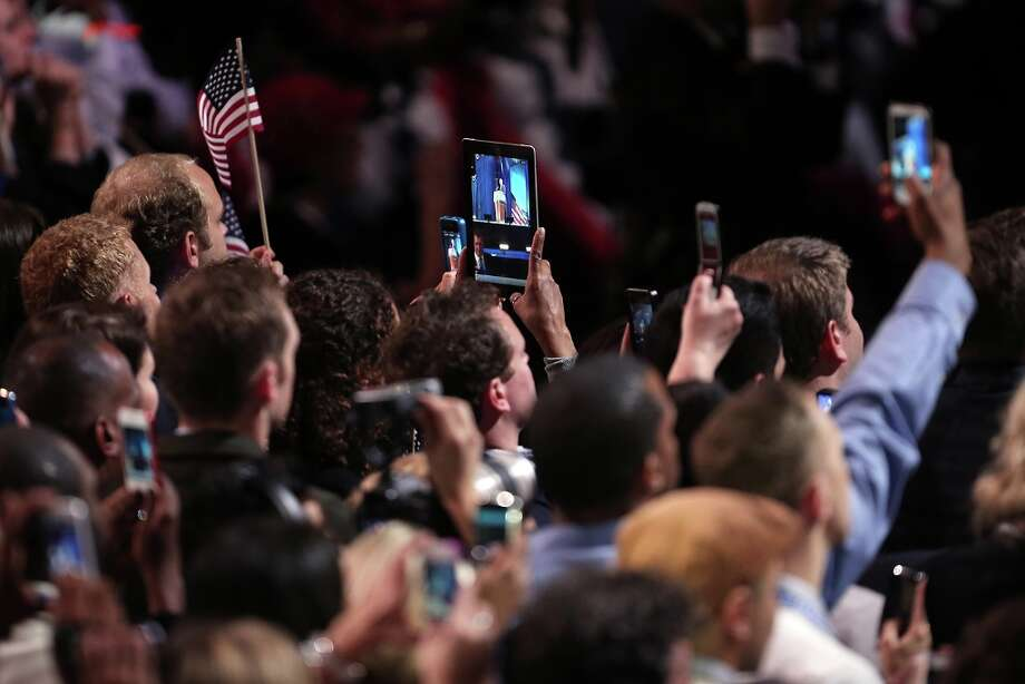 CHICAGO, IL - NOVEMBER 06:  Supporters take photos as U.S. President Barack Obama delivers his victory speech after being reelected for a second term at McCormick Place November 6, 2012 in Chicago, Illinois. Obama won reelection against Republican candidate, former Massachusetts Governor Mitt Romney.  (Photo by Spencer Platt/Getty Images) Photo: Spencer Platt, Getty Images / 2012 Getty Images