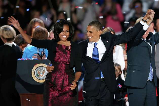 CHICAGO, IL - NOVEMBER 06:  U.S. President Barack Obama stands on stage with first lady Michelle Obama after his victory speech on election night at McCormick Place November 6, 2012 in Chicago, Illinois. Obama won reelection against Republican candidate, former Massachusetts Governor Mitt Romney.  (Photo by Scott Olson/Getty Images) Photo: Scott Olson, Getty Images / 2012 Getty Images