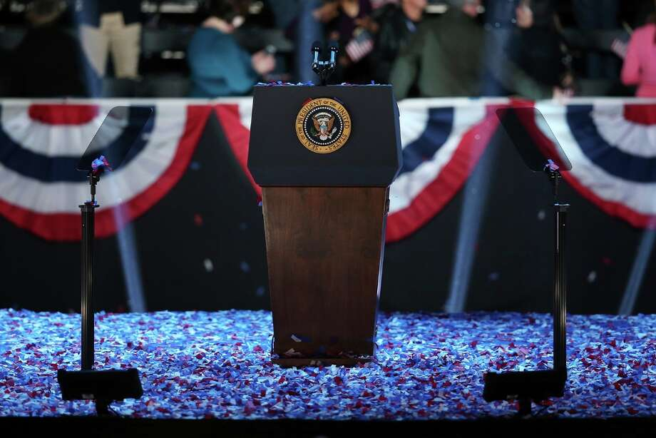 CHICAGO, IL - NOVEMBER 06:  The podium stands surrounded by confetti after U.S. President Barack Obama delivers his victory speech on election night at McCormick Place November 6, 2012 in Chicago, Illinois. Obama won reelection against Republican candidate, former Massachusetts Governor Mitt Romney.  (Photo by Scott Olson/Getty Images) Photo: Scott Olson, Getty Images / 2012 Getty Images