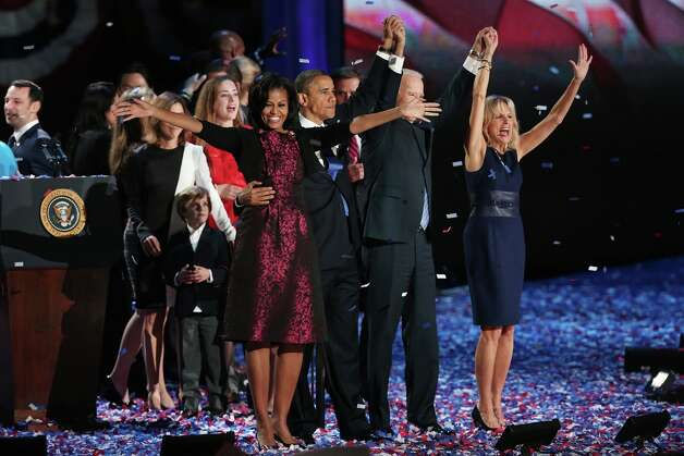 CHICAGO, IL - NOVEMBER 06:  U.S. President Barack Obama stands on stage with first lady Michelle Obama, U.S. Vice President Joe Biden and Dr. Jill Biden after his victory speech on election night at McCormick Place November 6, 2012 in Chicago, Illinois. Obama won reelection against Republican candidate, former Massachusetts Governor Mitt Romney.  (Photo by Win McNamee/Getty Images) Photo: Win McNamee, Getty Images / 2012 Getty Images