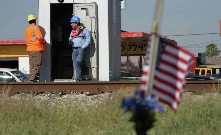 Railroad investigators work the scene where four veterans were killed after a train hit a parade float. Photo: Juan Carlos Llorca, STF / AP