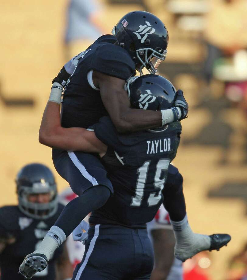 Rice's Donte Moore (left) celebrates bios 7-yard touchdown reception with teammate Jordan Taylor during the first half of a Conference USA college football game, Saturday, November 17, 2012 at Rice Stadium in Houston, TX. Photo: Eric Christian Smith, For The Chronicle