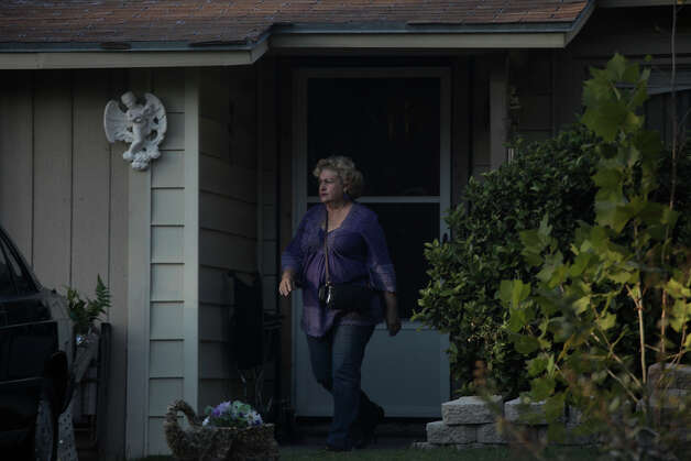Nancy Murrah walks out of her home, next to her former boarding house, Amistad Residential Facility, where four men were killed in a fire in August, on Friday, Nov. 16, 2012. Photo: Lisa Krantz, San Antonio Express-News / © 2012 San Antonio Express-News