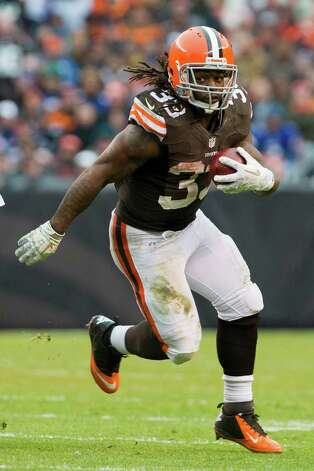 CLEVELAND, OH - NOVEMBER 4: Running back Trent Richardson #33 of the Cleveland Browns runs for a gain during the second half against the Baltimore Ravens at Cleveland Browns Stadium on November 4, 2012 in Cleveland, Ohio. The Ravens defeated the Browns 25-15. Photo: Jason Miller, Getty Images / 2012 Getty Images