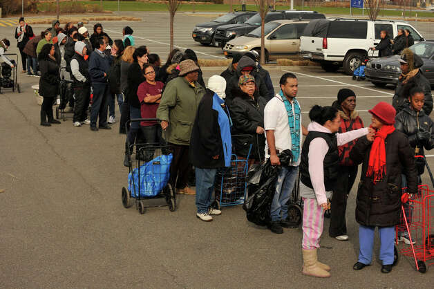 People stand in line waiting to receive donations in the Ikea parking lot in the Red Hook section of Brooklyn, N.Y., on Friday, Nov. 16, 2012. The donations were collected by volunteers from the Tunnel To Towers Foundation to aid New York City residents that were affected by Hurricane Sandy. Photo: Jason Rearick / The News-Times