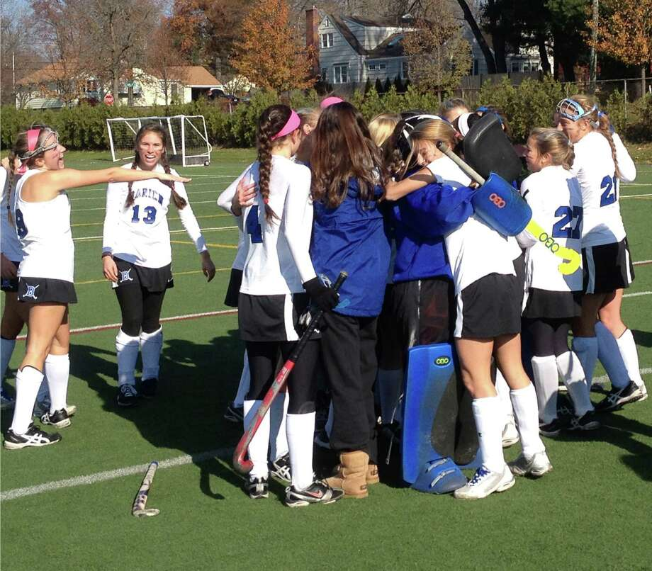 The Darien High School field hockey team celebrates after beating Cheshire 4-0 in the Class L field hockey championship on Saturday, Nov. 17, 2012 at Wethersfield High School. Photo: Jon Chik