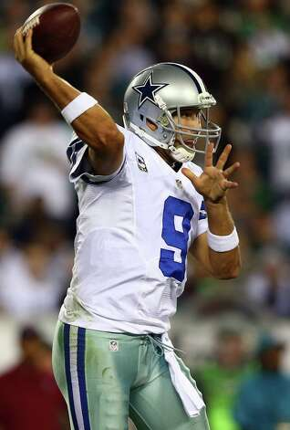 PHILADELPHIA, PA - NOVEMBER 11:  Tony Romo #9 of the Dallas Cowboys passes the ball in the third quarter against the Philadelphia Eagles on November 11, 2012 at Lincoln Financial Field in Philadelphia, Pennsylvania.The Dallas Cowboys defeated the Philadelphia Eagles 38-23. Photo: Elsa, Getty Images / 2012 Getty Images