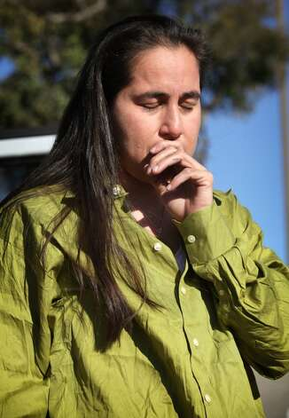 An emotional Anna Vasquez pauses before answering questions about three of her friends who are still in prison. Vasquez said she feels an obligation to them. (Photo by Bob Owen/Express-News)