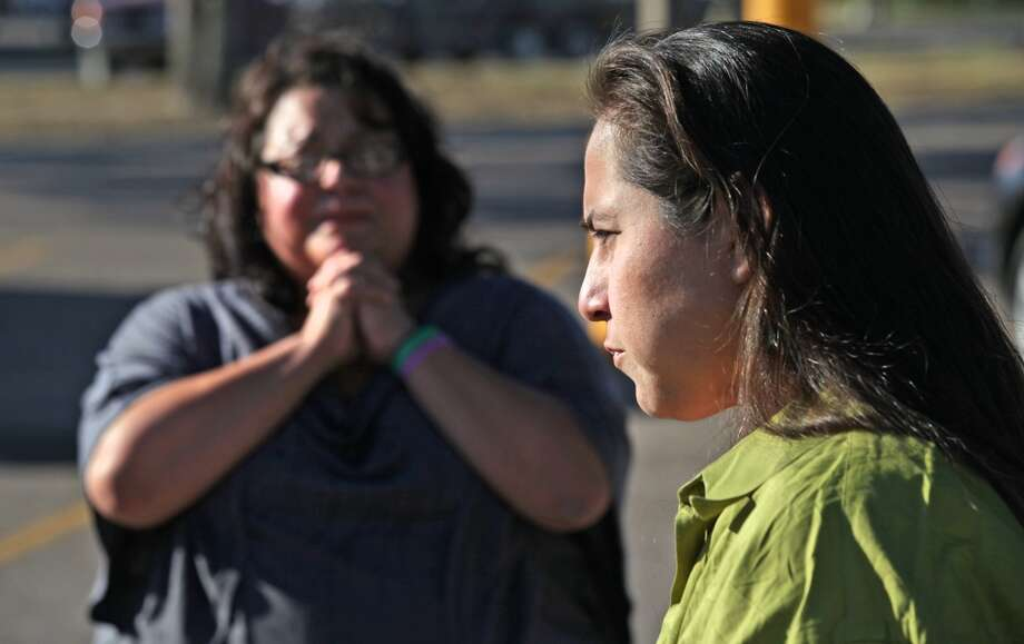 Anna Vasquez, right, answers questions, as her sister-in-law Rose Vasquez, left, gives thanks for Anna's release from prison.