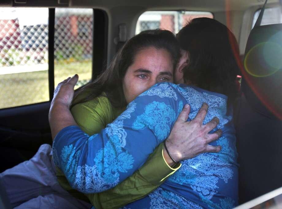 A tearful Anna Vasquez, left, embraces her mother Maria Vasquez.