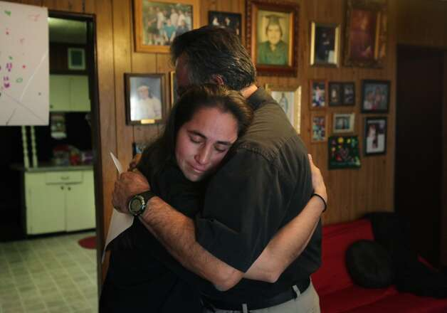 Anna Vasquez, left, appears safe in her brother Robert Vasquez's arms as she returned home after serving 12 and a half years in prison. (Photo by Bob Owen/Express-News)