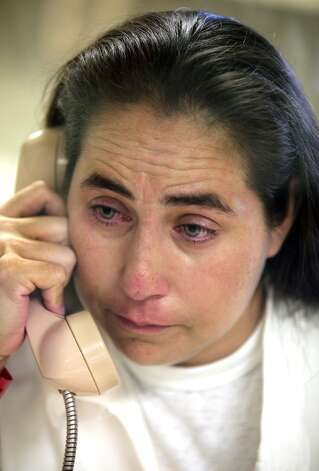 A tearful Anna Vasquez, 37, who was accused in 1994 of aggravated sexual assault of a child, speaks on a phone during a prison interview. She is incarcerated at the Murray Unit, in Gatesville, TX.  Tuesday September 4, 2012. (San Antonio Express-News)
