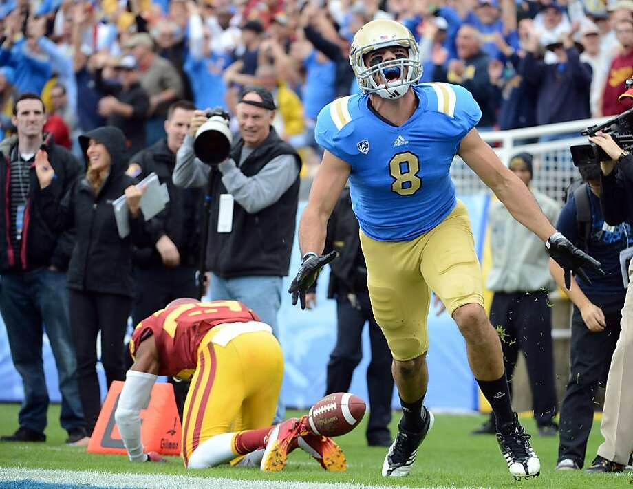 PASADENA, CA - NOVEMBER 17:  Joseph Fauria #8 of the UCLA Bruins celebrates his touchdown in front of Jawanza Starling #29 of the USC Trojans for a 17-0 lead at Rose Bowl on November 17, 2012 in Pasadena, California.  (Photo by Harry How/Getty Images) Photo: Harry How, Getty Images