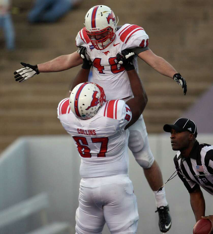 SMU's Zach Line is lifted by teammate Bryan Collins after Line's touchdown during the second half of a Conference USA college football game against Rice, Saturday, November 17, 2012 at Rice Stadium in Houston, TX. Photo: Eric Christian Smith, For The Chronicle