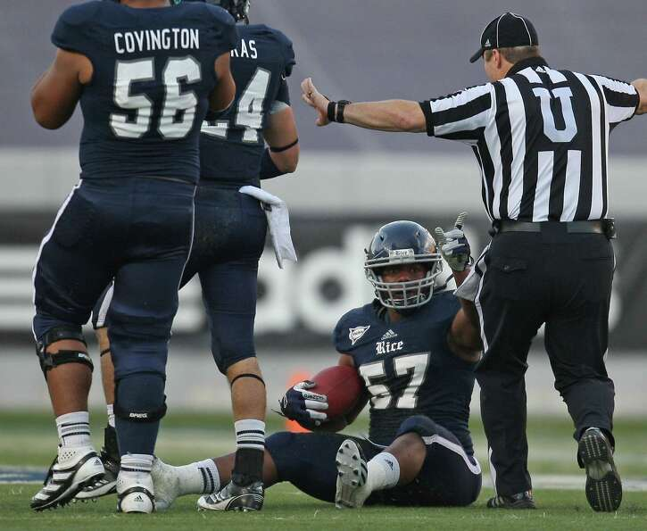 Rice's Cameron Nwosu signals possession as an official signals incomplete pas during the second half