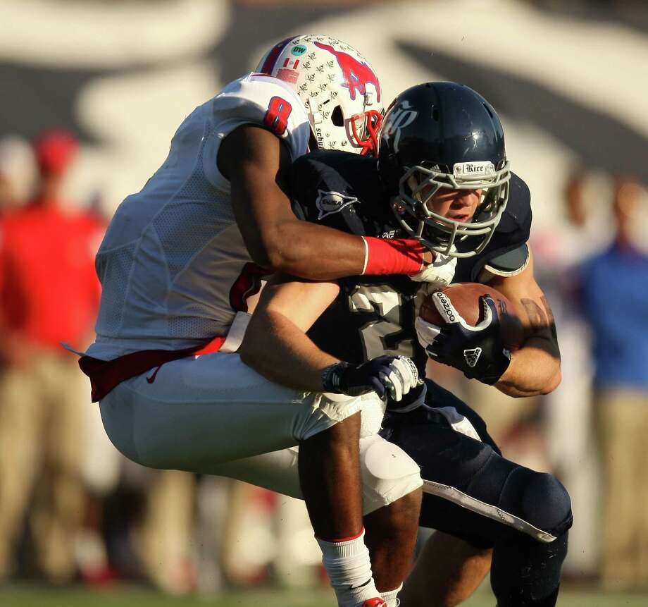 Rice's Charles Ross (right) is tackled by SMU's Jay Scott during the first half of a Conference USA college football game, Saturday, November 17, 2012 at Rice Stadium in Houston, TX. Photo: Eric Christian Smith, For The Chronicle