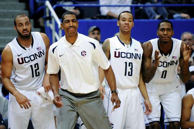 Connecticut coach Kevin Ollie watches action during the first half of their exhibition NCAA college basketball game against Massachusetts Lowell in Hartford, Conn., Sunday, Nov. 4, 2012. (AP Photo/Fred Beckham) Photo: Fred Beckham, Associated Press / FR153656 AP