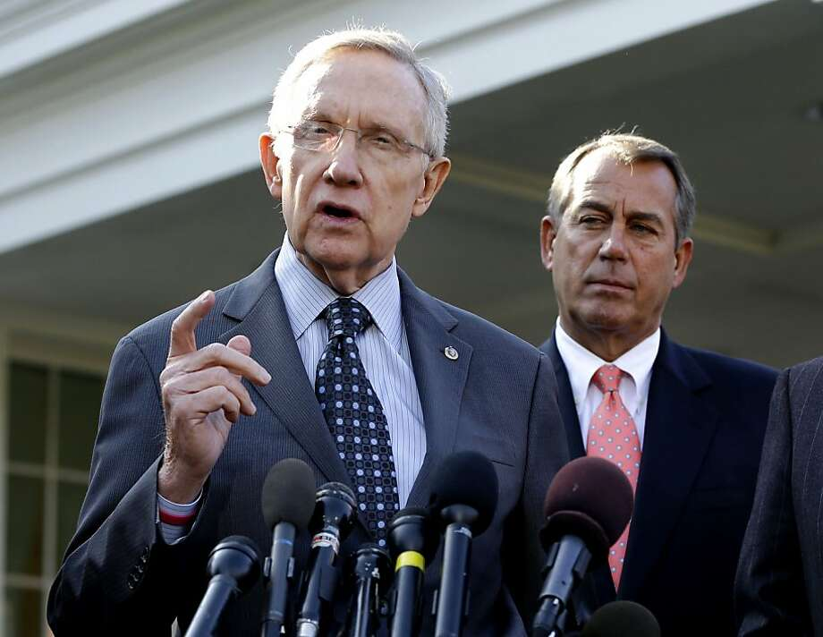Senator Harry Reid (left), speaking as House Speaker John Boehner listens, says he won't negotiate on Social Security. Photo: Jacquelyn Martin, Associated Press
