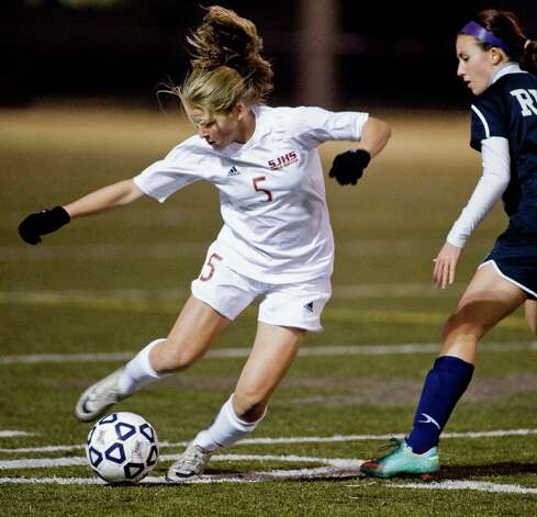 St. Joseph High School's Julia Marino dribbles the ball along against Rocky Hill High School in the Class M semifinals at Waterbury Municipal Stadium. Nov. 17, 2012 Photo: Scott Mullin / The News-Times Freelance