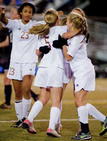 St. Joseph High School teammates celebrate a goal against Rocky Hill High School in the Class M semifinals at Waterbury Municipal Stadium. Nov. 17, 2012 Photo: Scott Mullin / The News-Times Freelance