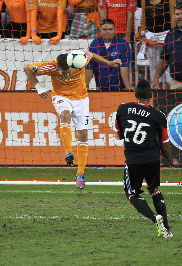 Bobby Boswell clears the ball off the Dynamo line to prevent a United score in the Eastern finals opener. Photo: Nick De La Torre, Staff / © 2012  Houston Chronicle