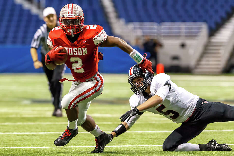 Judson's Jarveon Williams runs away from Churchill's Colton Teis during the third quarter of their Class 5A Division II first round game at the Alamodome on Nov 17, 2012.  Judson advanced to the second round with a 34-20 victory over the Chargers.  MARVIN PFEIFFER/ mpfeiffer@express-news.net Photo: MARVIN PFEIFFER, Express-News / Express-News 2012