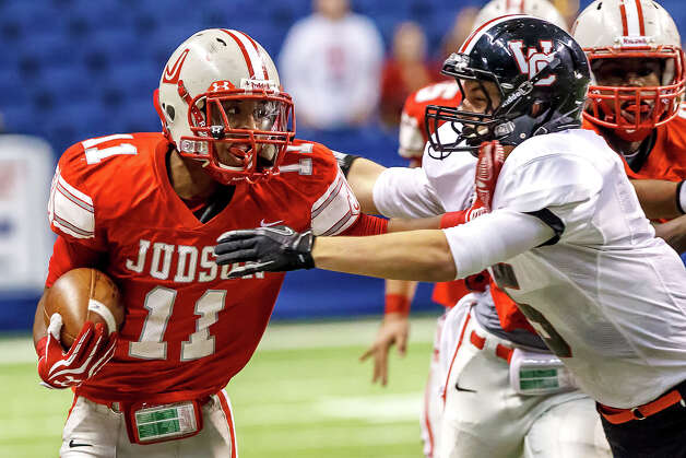 Judson's Andre Wilson (left) tries to fend off Churchill's Colton Teis during the third quarter of their Class 5A Division II first round game at the Alamodome on Nov 17, 2012.  Judson advanced to the second round with a 34-20 victory over the Chargers.  MARVIN PFEIFFER/ mpfeiffer@express-news.net Photo: MARVIN PFEIFFER, Express-News / Express-News 2012