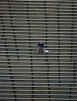 A fan watches the second half of a Conference USA college football game between Rice and SMU, Saturday, November 17, 2012 at Rice Stadium in Houston, TX. Photo: Eric Christian Smith, For The Chronicle