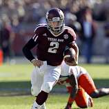 Johnny Manziel #2 of the Texas A&M Aggies looks for room to run against the Sam Houston State Bearkats at Kyle Field on November 17, 2012 in College Station, Texas.  (Bob Levey / Getty Images)
