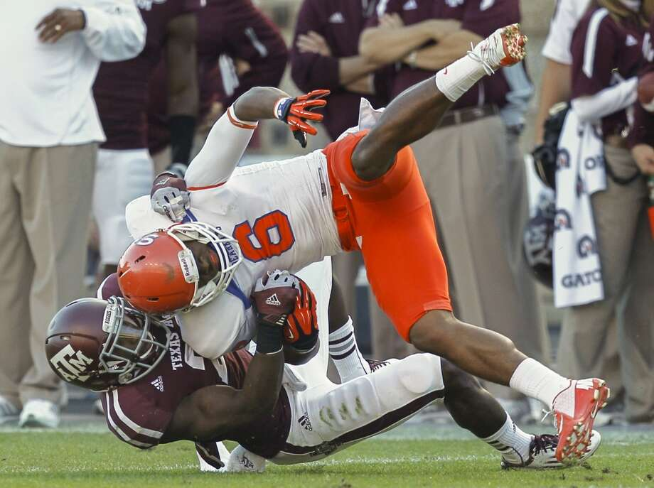Richard Sincere #6 of the Sam Houston State Bearkats is tackled by Steven Terrell #21 of the Texas A&M Aggies at Kyle Field on November 17, 2012 in College Station, Texas.  (Bob Levey / Getty Images)
