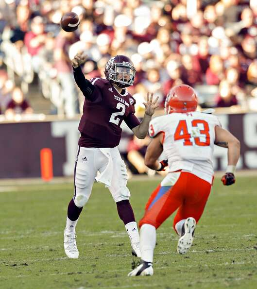 Johnny Manziel #2 of the Texas A&M Aggies throws downfield as Jesse Beauchamp #43 of the Sam Houston