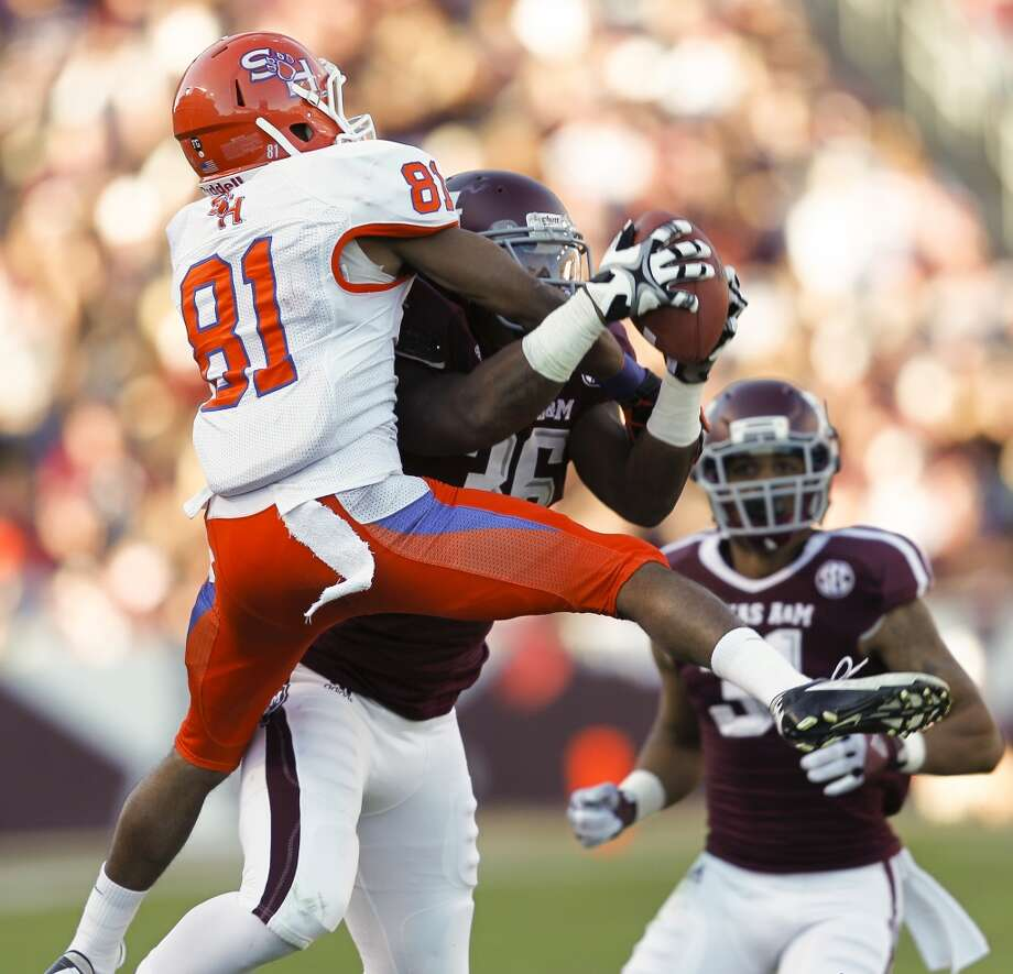 Donnie Baggs #36 of the Texas A&M Aggies intercepts a pass intended for Chance Nelson #81 of the Sam Houston State Bearkats at Kyle Field on November 17, 2012 in College Station, Texas.  (Bob Levey / Getty Images)