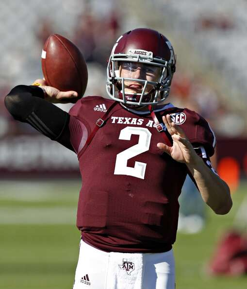 Johnny Manziel #2 of the Texas A&M Aggies warms up before playing Sam Houston State Bearkats at Kyle