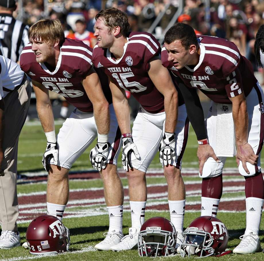 Ryan Swope #25 of the Texas A&M Aggies,Travis Labhart #15 of the Texas A&M Aggies and Johnny Manziel #2 of the Texas A&M Aggies at Kyle Field on November 17, 2012 in College Station, Texas.  (Bob Levey / Getty Images)