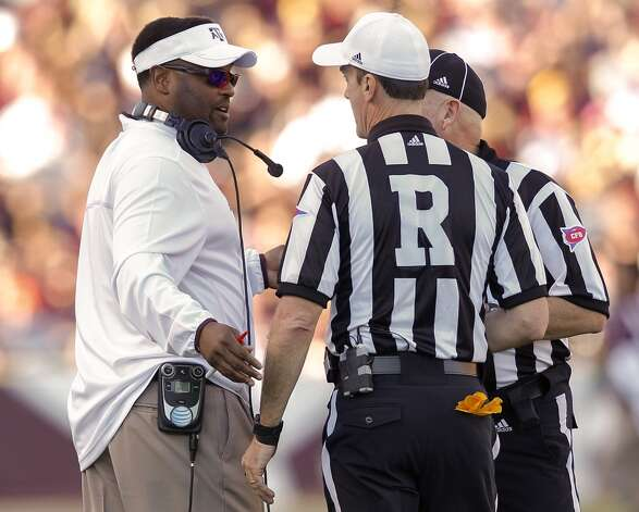 Texas A&M Aggies head coach Kevin Sumlin has words with the officials at Kyle Field on November 17, 2012 in College Station, Texas.  (Bob Levey / Getty Images)