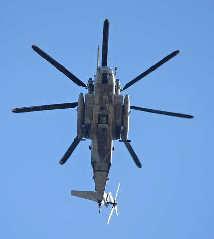 Helicopters from the Marine Heavy Helicopter Squadron 465 fly over during the national anthem at Kyle Field on November 17, 2012 in College Station, Texas.  (Bob Levey / Getty Images)