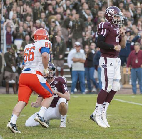 Texas A&M's Johnny Manziel (2) reacts after missing an extra point out of the hold by Ryan Epperson, center, as Sam Houston State's Gary Lorance (66) defends during the third quarter of an NCAA college football game, Saturday, Nov. 17, 2012, in College Station, Texas.  (Dave Einsel / Associated Press)