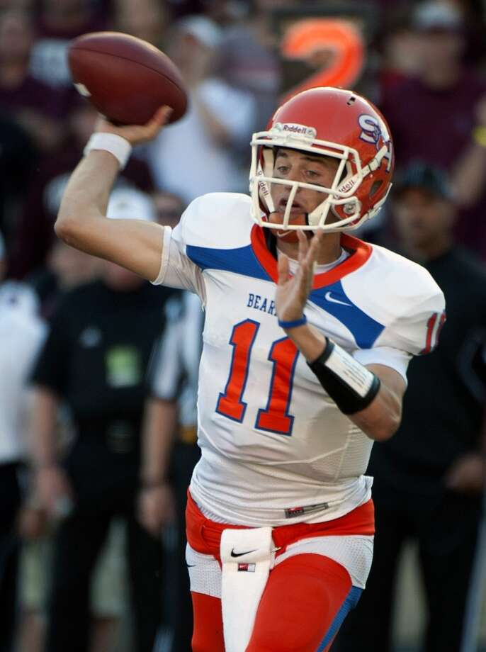 Sam Houston State's Brian Bell passes during the first quarter of an NCAA college football game against Texas A&M, Saturday, Nov. 17, 2012, in College Station, Texas.  (Dave Einsel / Associated Press)