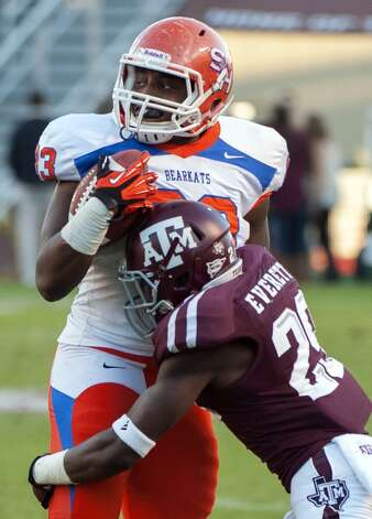 Texas A&M's Deshazor Everett, right, tackles Sam Houston State's T.J. Jones, left, during the third quarter of an NCAA college football game, Saturday, Nov. 17, 2012, in College Station, Texas. Texas A&M defeated Sam Houston State 47-28.  (Dave Einsel / Associated Press)
