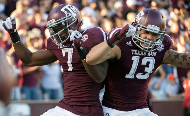 Texas A&M's Uzoma Nwachukwu (7) celebrates his touchdown reception with teammate Mike Evans (13) during the third quarter of an NCAA college football game against Sam Houston State, Saturday, Nov. 17, 2012, in College Station, Texas. (Dave Einsel / Associated Press)
