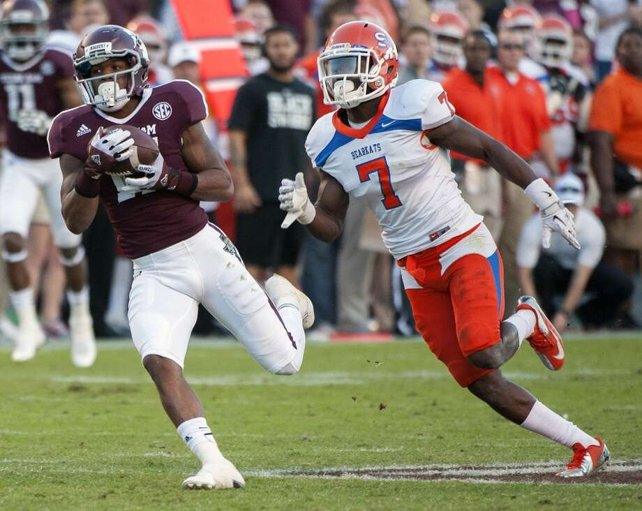 Texas A&M's LeKendrick Williams pulls in an 80-yard touchdown pass over Sam Houston State's Dax Swanson (7) during the third quarter of an NCAA college football game, Saturday, Nov. 17, 2012, in College Station, Texas. Texas A&M defeated Sam Houston State 47-28.  (Dave Einsel / Associated Press)
