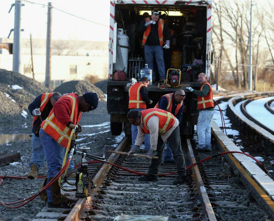 ISLAND PARK, NY - NOVEMBER 09:  Long Island Railroad workers work to repair tracks just east of Long Beach Road in the aftermath of Superstorm Sandy on November 9, 2012 in Island Park, New York. New York Gov. Andrew M. Cuomo has said that the economic loss and damage to homes and business caused by Sandy could total $33 billion in New York, according to published reports.  (Photo by Bruce Bennett/Getty Images) Photo: Bruce Bennett / 2012 Getty Images