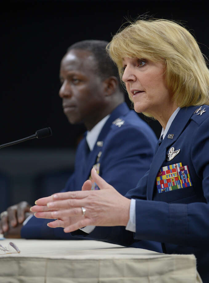 Maj. Gen. Margaret Woodward, commander of Air Force Safety Center at Kirtland Air Force Base, N.M., answers questions with Gen. Edward Rice Jr., commander of Air Education and Training Command, during a Nov. 14 Pentagon press briefing. The commanders outlined results of an investigaton into sexual misconduct among basic training instructors at Joint Base San Antonio-Lackland. Photo: Scott M. Ash, U.S. Air Force / Nikon D4