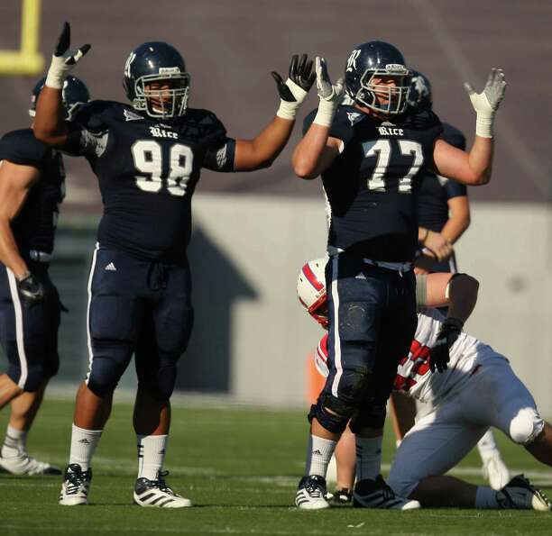 Rice's Jamael Williiams (98) and Andrew Reue (77) signal field goal after kicker Chris Boswell's 56-