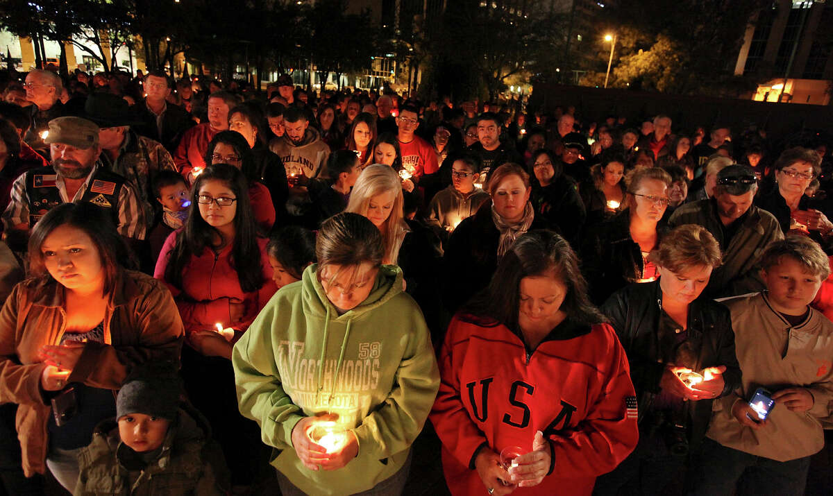 About 200 people attend a candlelight vigil held at Centennial Plaza, in downtown Midland, Tx., Saturday Nov. 17, 2012, to remember people involved in an accident where a Union Pacific train struck a float carrying military veterans,Thursday Nov. 15, 2012, killing four men, including one from the San Antonio area.
