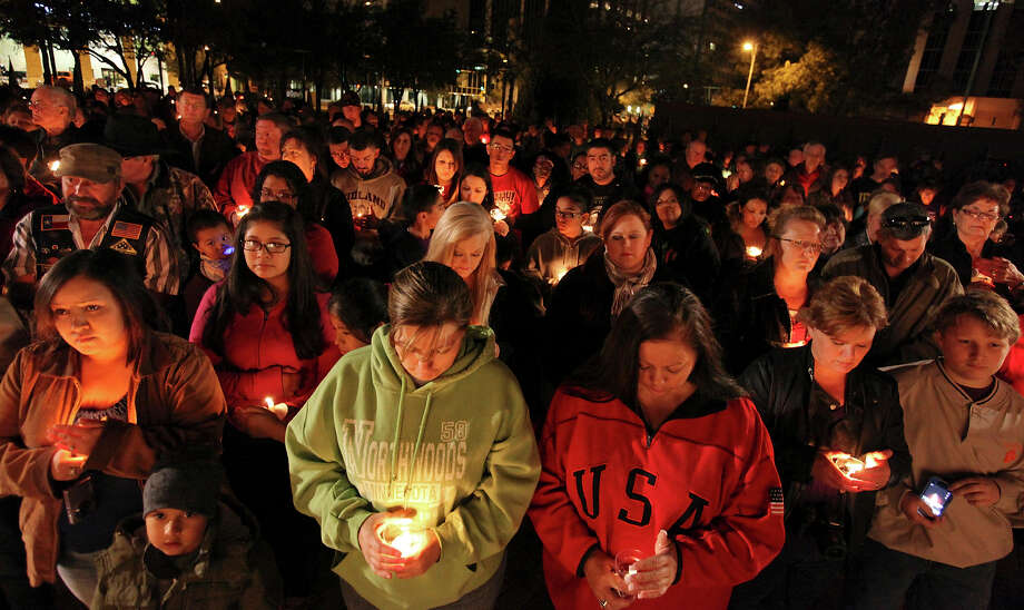 About 200 people attend a candlelight vigil held at Centennial Plaza, in downtown Midland, Tx., Saturday Nov. 17, 2012, to remember people involved in an accident where a Union Pacific train struck a float carrying military veterans,Thursday Nov. 15, 2012, killing four men, including one from the San Antonio area. Photo: Edward A. Ornelas, San Antonio Express-News / © 2012 San Antonio Express-News