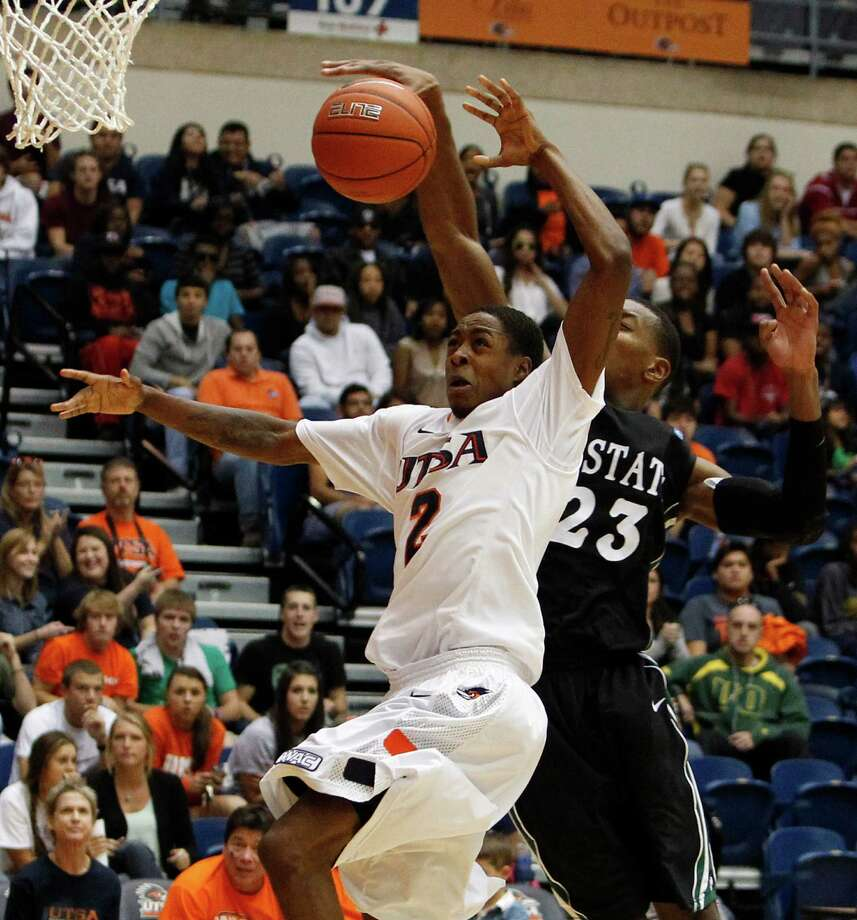 UTSA's Hyjii Thomas, left, has his shot blocked by South Carolina Upstate's Torrey Craig during second half action at UTSA's Convocation Center on Saturday, Nov. 17, 2012. UTSA won 67-59. MICHAEL MILLER / FOR THE EXPRESS-NEWS Photo: Michael Miller, Express-News / © San Antonio Express-News